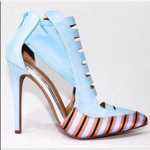 Luanza blue heel has a silver strip along the arch